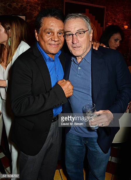 Roberto Duran and Robert De Niro attend a starstudded dinner hosted by DEAN DELUCA Harvey Weinstein Charles Finch to celebrate Robert De Niro in his...
