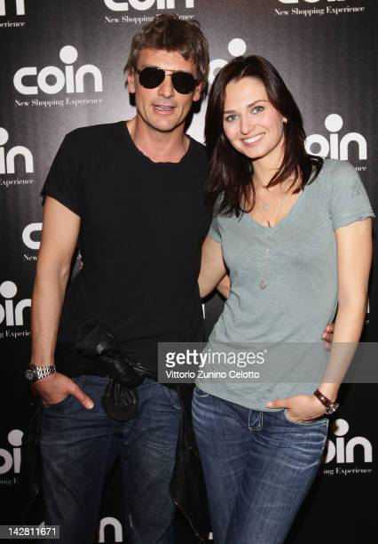 Roberto Farnesi and Anna Safroncik attend 'Let's Party' by Coin on April 12 2012 in Milan Italy