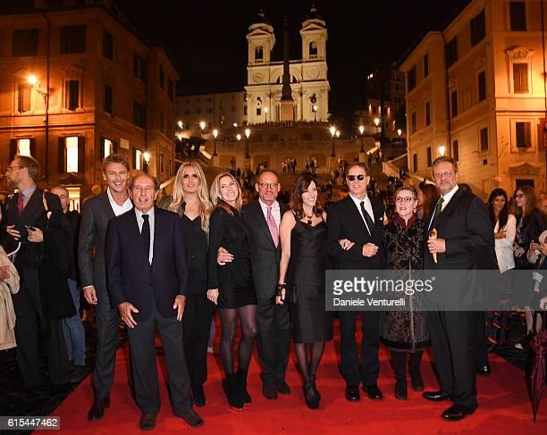 Roberto Farnesi Gianni Battistini Tiziana Rocca Paula Peck Anthony Peck Cecilia Peck Daniel Voll and guests attend 'Red Carpet In Via Condotti' on...