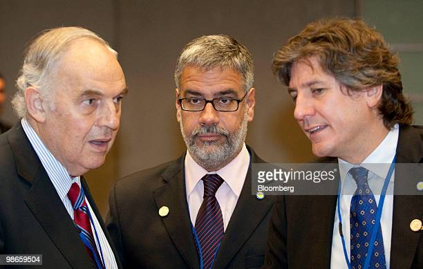 Roberto Feletti vicepresident of Banco de la Nacion SA center listens to Amado Boudou economy minister of Argentina center talk to during the...