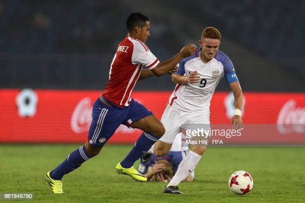 Roberto Fernandez of Paraguay and Josh Sargent of USA battle for the ball during the FIFA U17 World Cup India 2017 Round of 16 match between Paraguay...