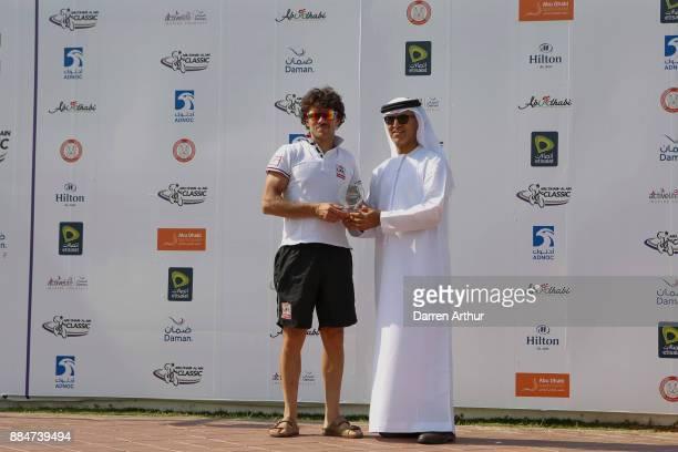 Roberto Ferrari accepts his trophy for finishing 3rd during the Abu Dhabi - Al Ain Classic on December 3, 2017 in Abu Dhabi, Unite