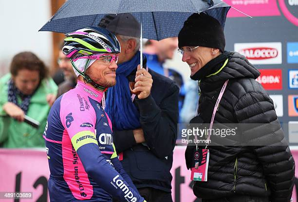 Roberto Ferrari of Italy and Lampre-Merida waits under an umbrella ahead of the second stage of the 2014 Giro d'Italia, a 219km flat road stage on...