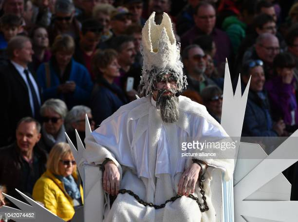 Roberto Fink dressed up as 'Herr Winter' in chains photographed during the traditional spring festival parade in Eisenach Germany 25 March 2017 This...