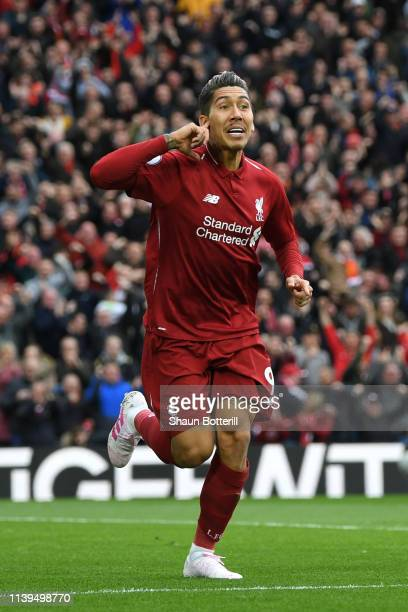 Roberto Firminho of Liverpool celebrates after he scores his sides first goal during the Premier League match between Liverpool FC and Tottenham...
