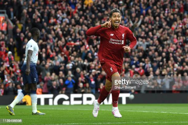Roberto Firminho of Liverpool celebrates after scores his sides first goal during the Premier League match between Liverpool FC and Tottenham Hotspur...