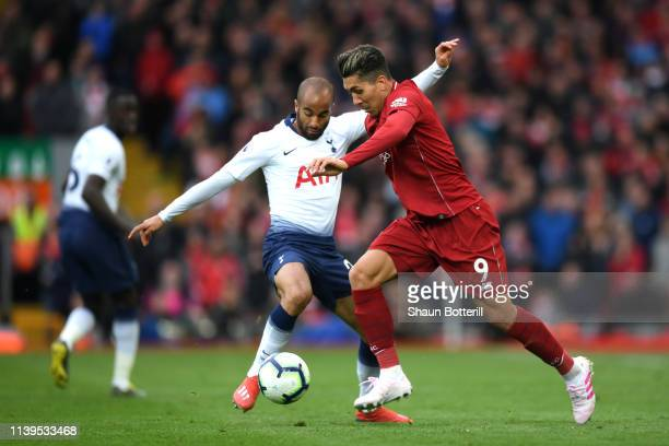 Roberto Firminho of Liverpool goes past Lucas Mora of Tottenham Hotspur during the Premier League match between Liverpool FC and Tottenham Hotspur at...