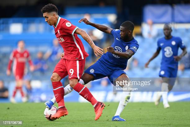 Roberto Firminho of Liverpool is challenged by Fikayo Tomori of Chelsea during the Premier League match between Chelsea and Liverpool at Stamford...