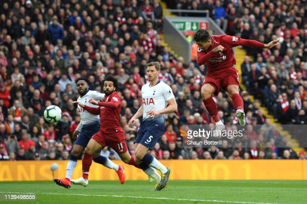 Roberto Firminho of Liverpool scores his sides first goal during the Premier League match between Liverpool FC and Tottenham Hotspur at Anfield on...