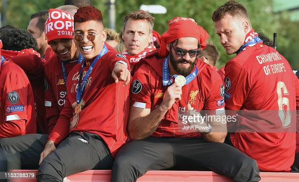 Roberto Firmino Alisson Becker and Simon Mignolet of Liverpool celebrate on board an opentop bus during the UEFA Champions League victory parade...