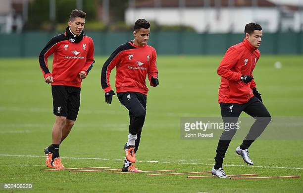Roberto Firmino Allan Rodrigues de Souza and Philippe Coutinho of Liverpool during a training session at Melwood Training Ground on December 24 2015...
