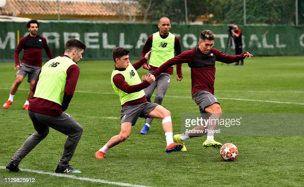 Roberto Firmino and Adam Lewis of Liverpool during a training session on February 15 2019 in Marbella Spain