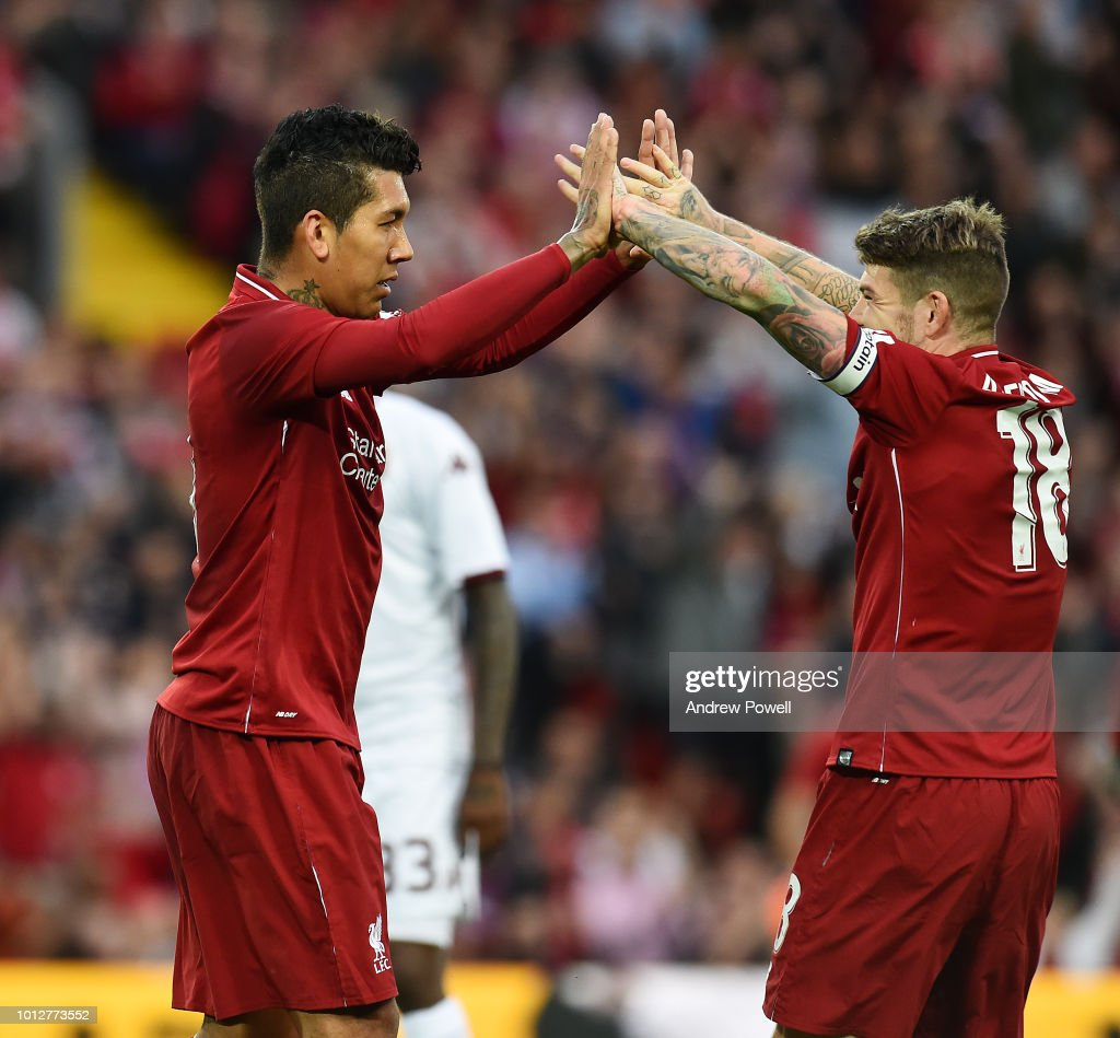 Roberto Firmino and Alberto Moreno of Liverpool celebrate after scoring the opening goal during the Pre-Season friendly match between Liverpool and Torino at Anfield on August 7, 2018 in Liverpool, England.