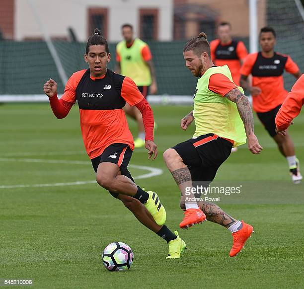 Roberto Firmino and Alberto Moreno of Liverpool during a training session at Melwood Training Ground on July 6 2016 in Liverpool England