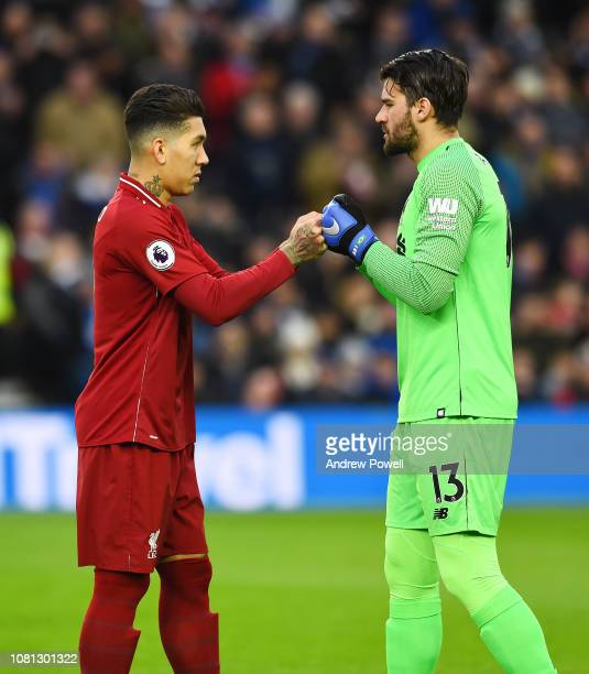 Roberto Firmino and Alisson Becker of Liverpool before the Premier League match between Brighton Hove Albion and Liverpool FC at American Express...