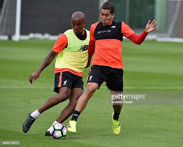 Roberto Firmino and Andre Wisdom of Liverpool during a training session at Melwood Training Ground on July 6 2016 in Liverpool England