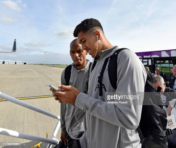 Roberto Firmino and Fabinho of Liverpool boarding a flight ready to travel to Naples on September 16 2019 in Liverpool England