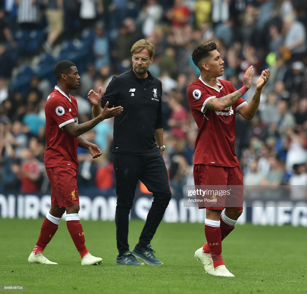Roberto Firmino and Georginio Wijnaldum of Liverpool with Jurgen Klopp at the end of the Premier League match between West Bromwich Albion and Liverpool at The Hawthorns on April 21, 2018 in West Bromwich, England.