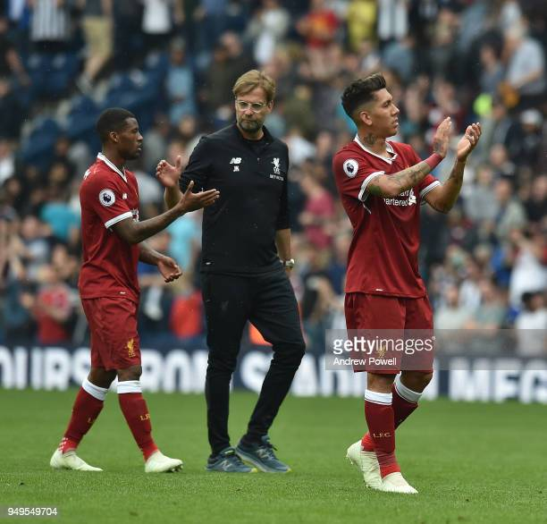 Roberto Firmino and Georginio Wijnaldum of Liverpool with Jurgen Klopp at the end of the Premier League match between West Bromwich Albion and...