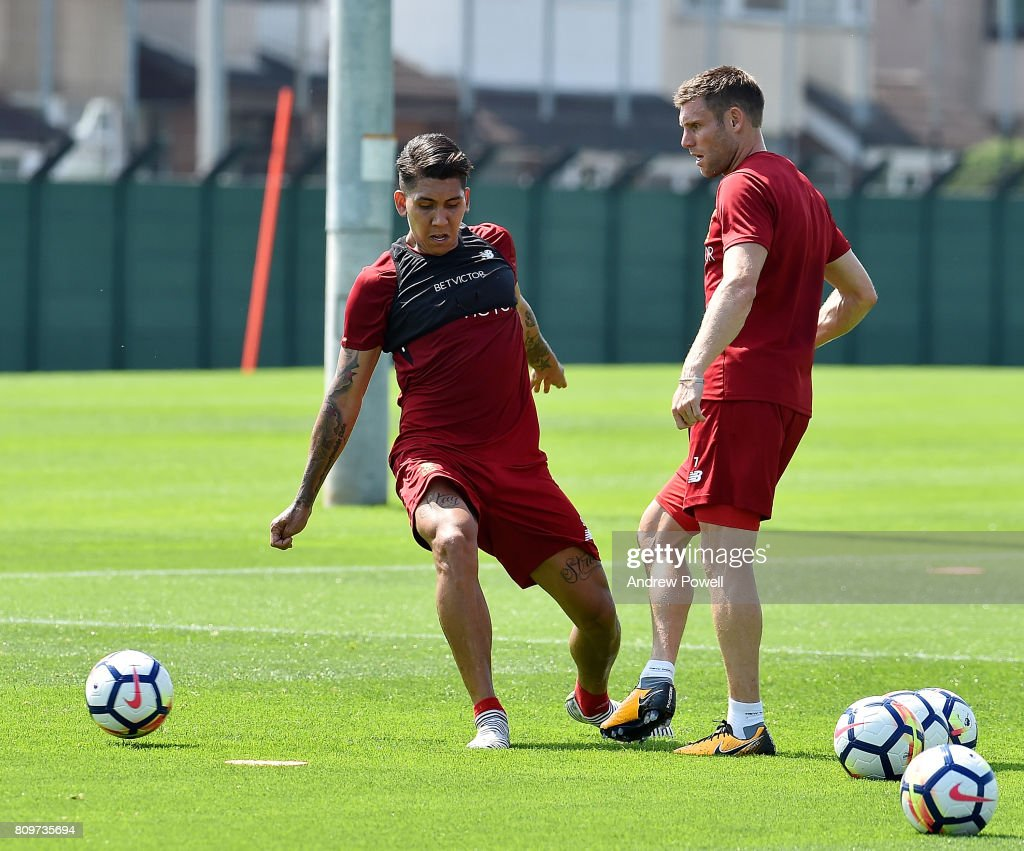 Roberto Firmino and James Milner of Liverpool during a training session at Melwood Training Ground on July 6, 2017 in Liverpool, England.