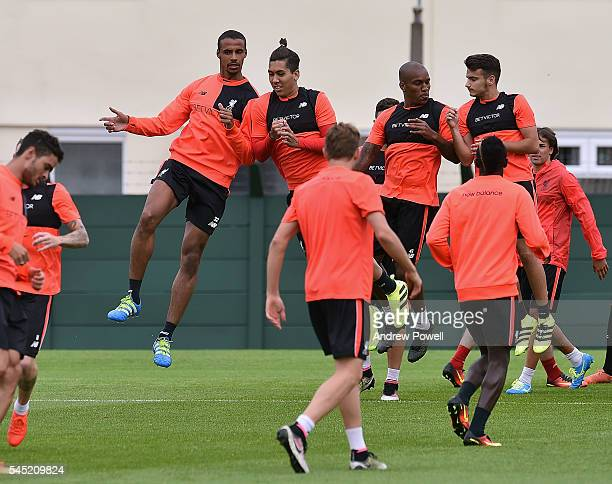 Roberto Firmino and Joel Matip of Liverpool during a training session at Melwood Training Ground on July 6 2016 in Liverpool England