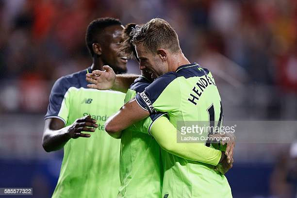 Roberto Firmino and Jordan Henderson of Liverpool FC celebrate a goal against AC Milan during the International Champions Cup match at Levi's Stadium...
