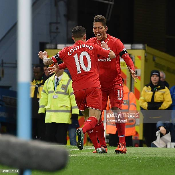 Roberto Firmino and Philippe Coutinho of Liverpool celebrates the opening goal during the Barclays Premier League match between Manchester City and...