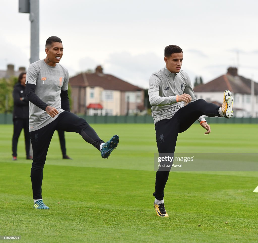 Roberto Firmino and Philippe Coutinho of Liverpool during a training session at Melwood Training Ground on September 12, 2017 in Liverpool, United Kingdom.