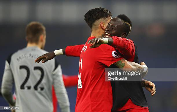 Roberto Firmino and Sadio Mane of Liverpool celebrate victory after the Premier League match between Everton and Liverpool at Goodison Park on...