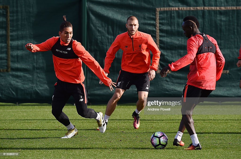 Roberto Firmino and Sadio Mane of Liverpool during a training session at Melwood Training Ground on October 19, 2016 in Liverpool, England.