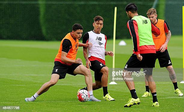 Roberto Firmino and Tiago Ilori of Liverpool in action during a training session at Melwood Training Ground on August 22 2015 in Liverpool England