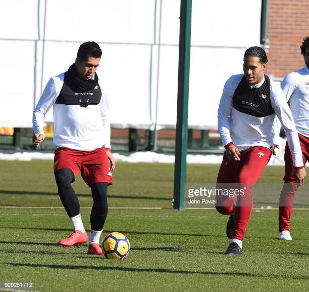 Roberto Firmino and Virgil van Dijk of Liverpool during a training session at Melwood Training Ground on March 8 2018 in Liverpool England