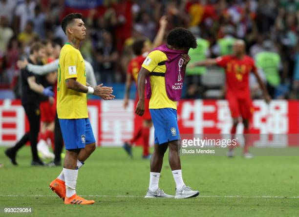 Roberto Firmino and Willian of Brazil looks dejected following his sides defeat in the 2018 FIFA World Cup Russia Quarter Final match between Brazil...