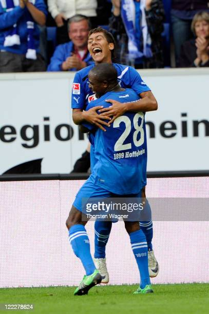 Roberto Firmino celebrates the opening goal with his team mate Edson Braafheid during the Bundesliga match between TSG 1899 Hoffenheim and SV Werder...