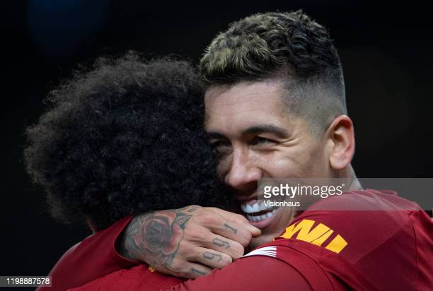 Roberto Firmino celebrates with Mo Salah after scoring the winning goal for Liverpool FC during the Premier League match between Tottenham Hotspur...