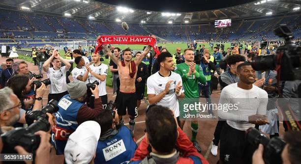 Roberto Firmino Dejan Lovren Simon Mignolet Georginio Wijnaldum and Ragnar Klavan of Liverpool celebrates with the fans at the end of the UEFA...