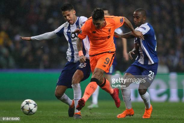Roberto Firmino forward of Liverpool in action with Porto's Portuguese defender Ricardo Pereira and Porto's Mexican defender Diego Reyes during the...