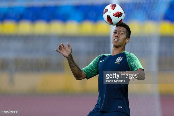 Roberto Firmino in action during a Brazil training session ahead of the the 2018 FIFA World Cup Russia Quarter Final match between Brazil and Belgium...