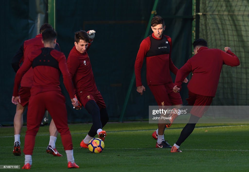Roberto Firmino, Kamil Grabara and Marko Grujic of Liverpool during a training session at Melwood Training Ground on November 16, 2017 in Liverpool, England.