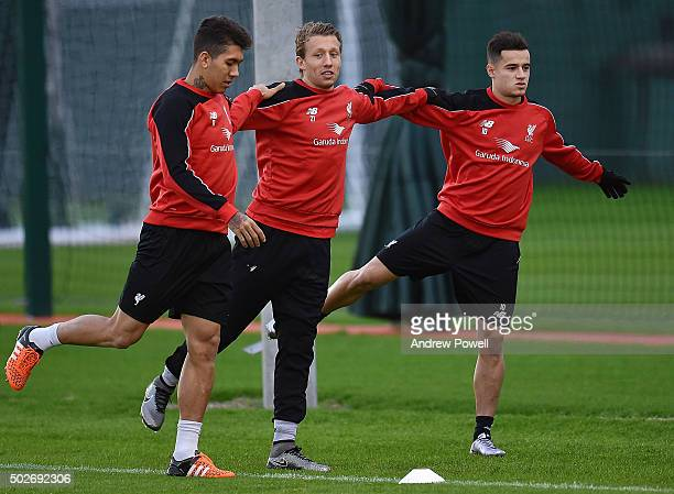 Roberto Firmino Lucas Leiva and Philippe Coutinho of Liverpool in action during a training session at Melwood Training Ground on December 28 2015 in...