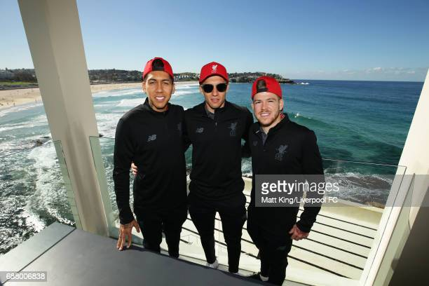 Roberto Firmino Lucas Levia and Alberto Moreno of Liverpool pose during a Liverpool FC Fan Day at Bondi Beach on May 25 2017 in Sydney Australia
