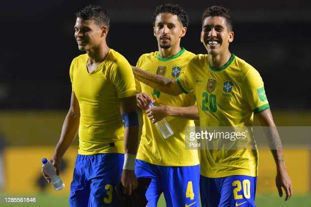 Roberto Firmino, Marquinhos and Thiago Silva of Brazil celebrate after a match between Brazil and Venezuela as part of South American Qualifiers for...