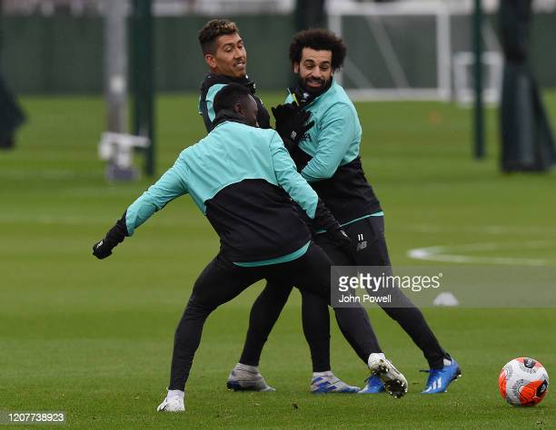 Roberto Firmino Mohamed Salah and Naby Keita of Liverpool during a training session at Melwood Training Ground on February 21 2020 in Liverpool...