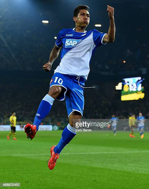 Roberto Firmino of 1899 Hoffenheim celebrates after scoring his teams second goal during the DFB Cup Quarter Final match between at Borussia Dortmund...