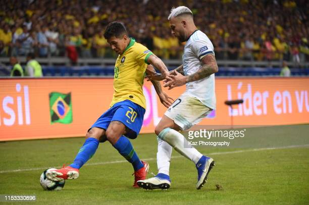 Roberto Firmino of Brasil keeps the ball under the pressure from Nicolas Otamendi of Argentina during the Copa America Brazil 2019 Semi Final match...