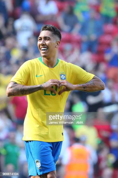 Roberto Firmino of Brazil celebrates after scoring a goal to make it 20 during the International friendly match between Croatia and Brazil at Anfield...