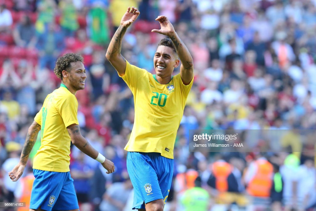 Roberto Firmino of Brazil celebrates after scoring a goal to make it 2-0 during the International friendly match between Croatia and Brazil at Anfield on June 3, 2018 in Liverpool, England.
