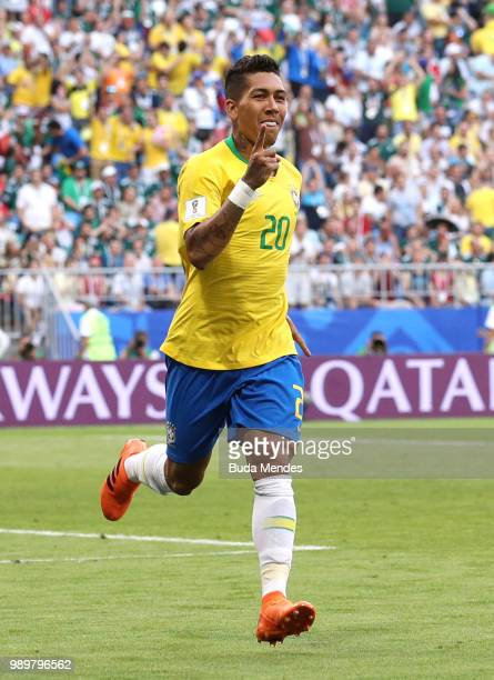 Roberto Firmino of Brazil celebrates after scoring his team's second goal during the 2018 FIFA World Cup Russia Round of 16 match between Brazil and...