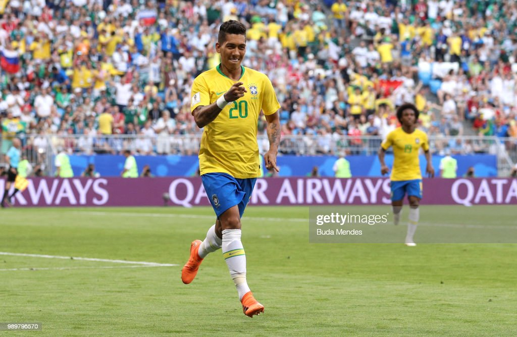 Roberto Firmino of Brazil celebrates after scoring his team's second goal during the 2018 FIFA World Cup Russia Round of 16 match between Brazil and Mexico at Samara Arena on July 2, 2018 in Samara, Russia.