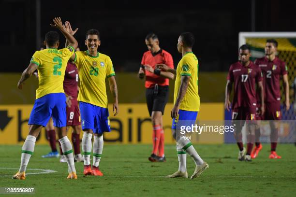 Roberto Firmino of Brazil celebrates after scoring the first goal of his team during a match between Brazil and Venezuela as part of South American...